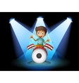A young drummer in the middle of the stage vector image