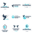set of international peace day logos or emblems vector image vector image
