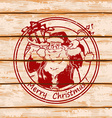 Santa Claus on a wooden boards vector image vector image