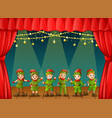 christmas elves performing on stage vector image vector image