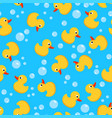 seamless background with yellow rubber duck toy vector image
