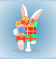 easter bunny keeps a big mountain of gifts the vector image vector image