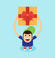 young man raise gift box his hand above his vector image vector image