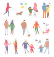 set of walking people in winter isolated vector image