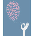 Hand holding a balloon with hearts vector image vector image