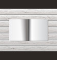 open book on wooden table vector image vector image