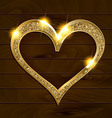 gold frame heart on wooden background vector image vector image