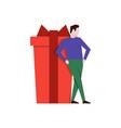 man leaned on big gift box vector image vector image