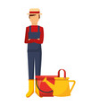 gardener man with watering can and bucket vector image