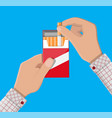 hand with cigarette package vector image vector image