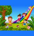 cartoon kids sliding down the rainbow vector image vector image