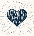 heart shape with lettering love is in the air vector image vector image