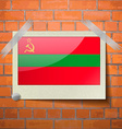 Flags Transnistria scotch taped to a red brick vector image