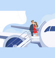 guy and girl go downstairs from plane vector image vector image