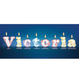 VICTORIA written with burning candles vector image vector image
