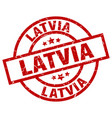 latvia red round grunge stamp vector image vector image
