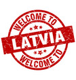 welcome to latvia red stamp vector image vector image