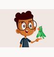 african boy holding a little parrot