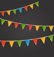 color triangle flags garland on dark background vector image vector image