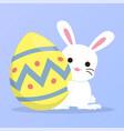 white bunny holding easter egg vector image
