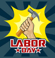 happy labor day hand holding hammer vector image vector image