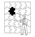businessman holding a piece jigsaw puzzle vector image vector image