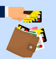 hand taking credit card from wallet vector image vector image