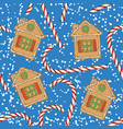 seamless pattern candy cane and gingerbread vector image vector image