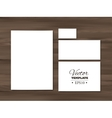 Corporate identity templates on a wooden vector image