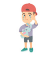 caucasian boy in a cap crying and holding toy vector image vector image