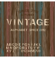 Vintage stamp alphabet and wooden background vector image vector image