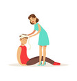 woman bandaging the head of the injured man young vector image vector image