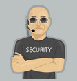 Security guard standing with crossed arms vector image