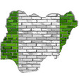 nigeria map on a brick wall vector image vector image