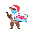 ox in santa hat holding merry christmas banner vector image
