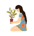 girl holding potted flower in hands floral vector image vector image