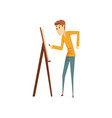 artist painting on canvas standing near easel vector image vector image