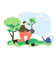 man ecologist volunteer planting tree in city vector image