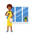 beautiful young black woman washing window with vector image vector image