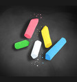 pieces of chalk on blackboard background vector image vector image