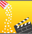 popcorn falling from round box open clapper board vector image