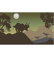 Silhouette of triceratops and baby T-Rex vector image vector image