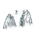 Businessman goes on a tightrope in the mountains
