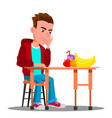 sad child at the table with food refuses to eat vector image vector image