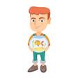 caucasian boy holding aquarium with goldfish vector image vector image