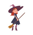 cute red haired girl witch standing with broom vector image vector image