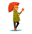 woman in coat and rubber boots stands under vector image