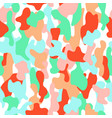 Camouflage seamless pattern in a pink orange