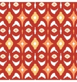 Red and gold ikat geometric seamless pattern vector image