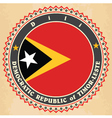 Vintage label cards of East Timor flag vector image vector image